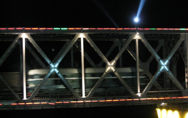 Train-at-night-headed-into-North-Korea-at-Dandong-bridge