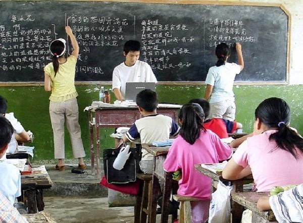 James with Volunteers Teaching Singing Class in the Rural School, 2006 Henan